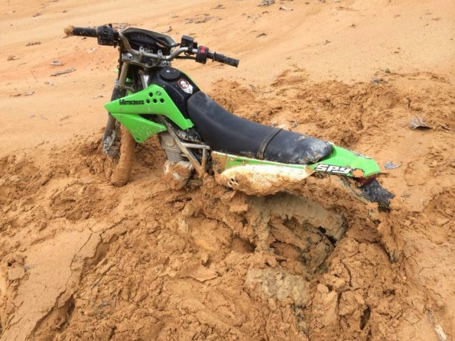 Friend's bike stuck in soft mud.